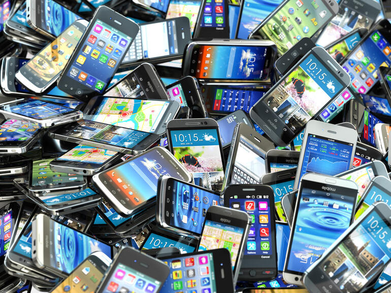 Recycle Pile of different modern smartphones