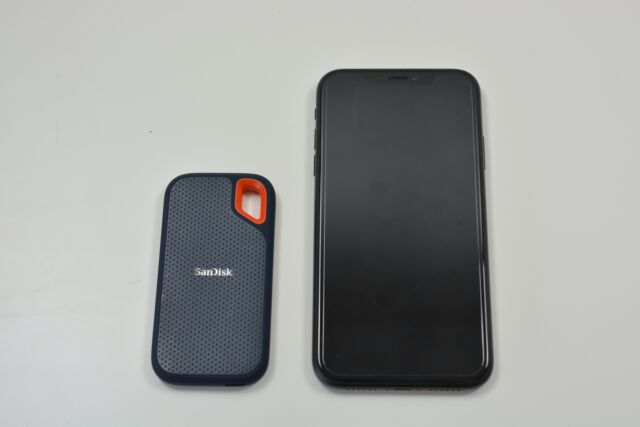 The SanDisk Extreme portable SSD next to an iPhone XR.