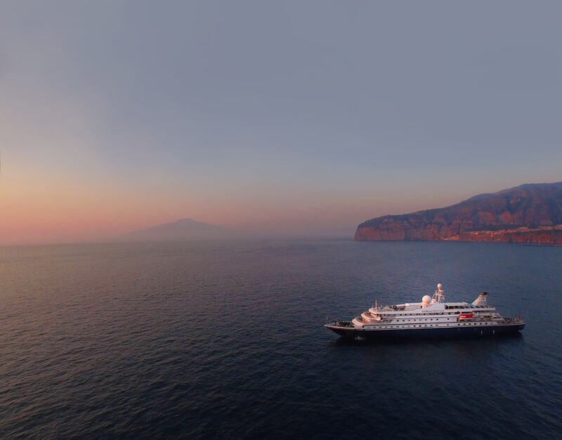 A relatively small luxury liner at sea.
