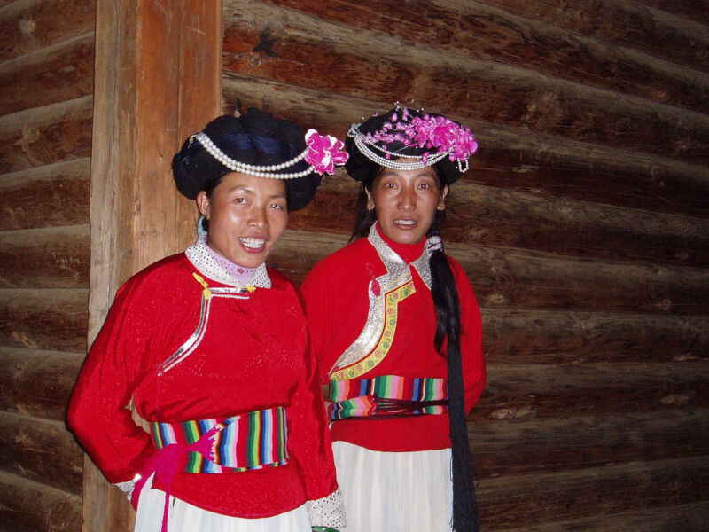 Two women in red clothing.