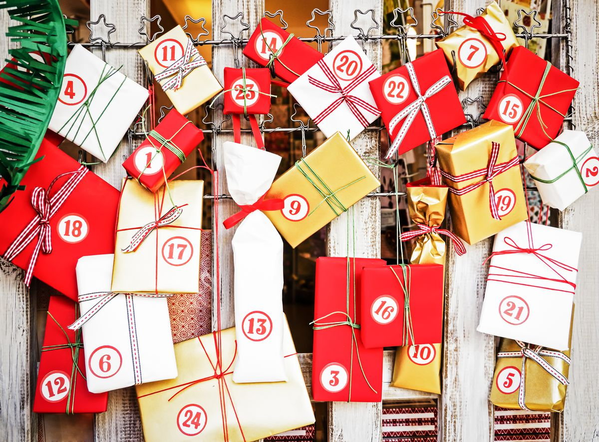 A collection of wrapped presents numbered for each of the days of Advent.
