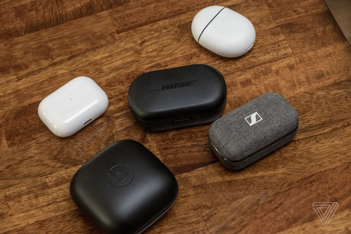 Bose's QuietComfort Earbuds case next to cases for the AirPods, Pixel Buds, Powerbeats Pro, and Sennheiser Momentum True Wireless 2.