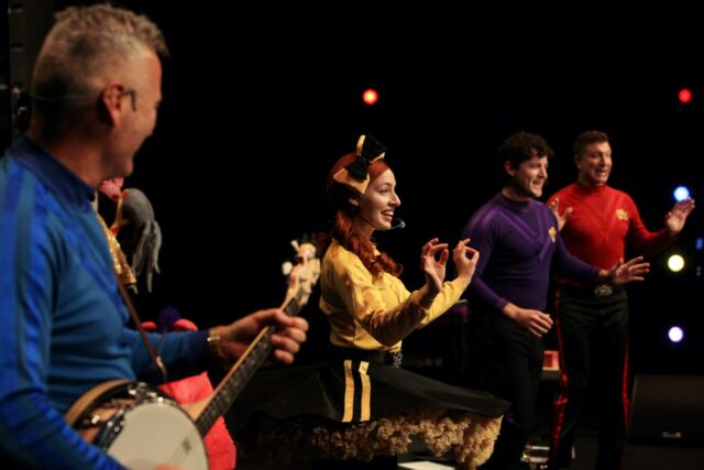 Anthony Field, Emma Watkins, Lachlan Gillespie and Simon Pryce of The Wiggles perform on stage with guitarist Oliver Brian during a live-streaming event at the Sydney Opera House on June 13, 2020 in Sydney, Australia.