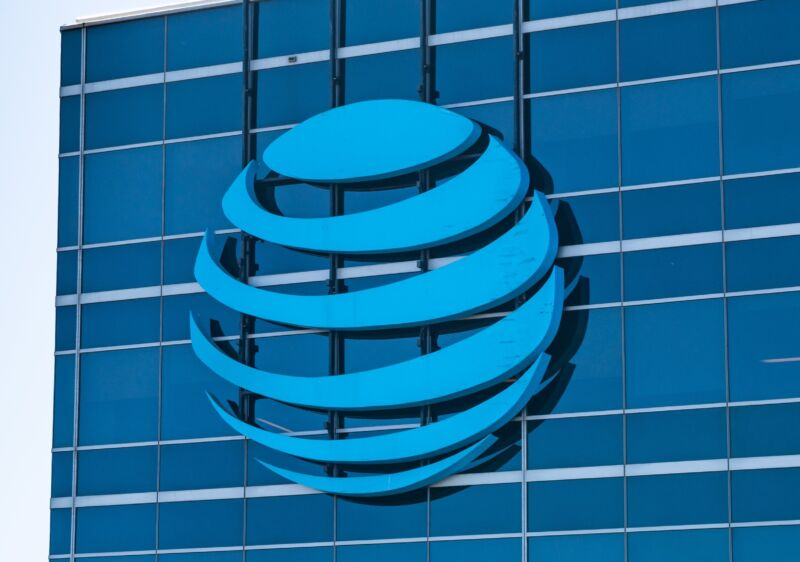 A large AT&T logo seen on the outside of its corporate offices.