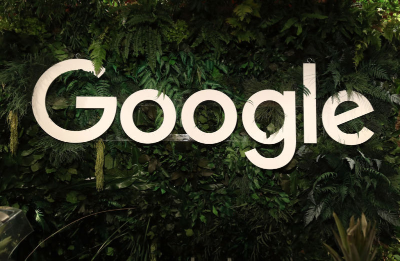 A large Google logo is displayed amidst foliage.