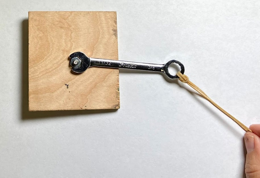 wrench bolt and wooden block