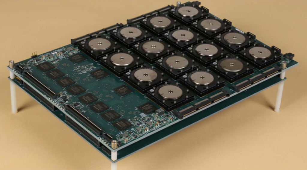 """A 4x4 array of neuromorphic chips, released as part of DARPA's SyNAPSE project. Designed by IBM, the chip has over 5 billion transistors and more than 250 million """"synapses."""""""