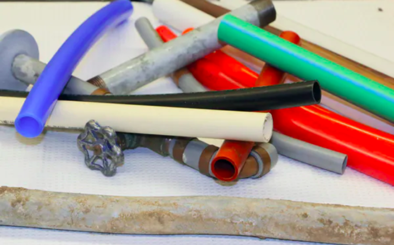 Some common types of drinking water pipes: Black plastic is HDPE; white is PVC; yellow is CPVC; red, maroon, orange, and blue are PEX; green is PP; and gray is polybutylene. The metal pipes are lead, iron and copper.
