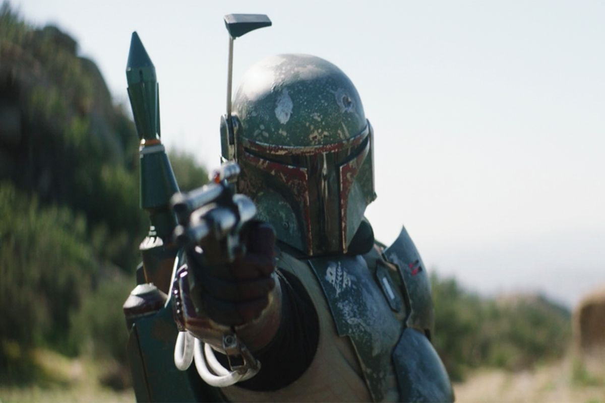Boba Fett aims his blaster right at some Stormtroopers.