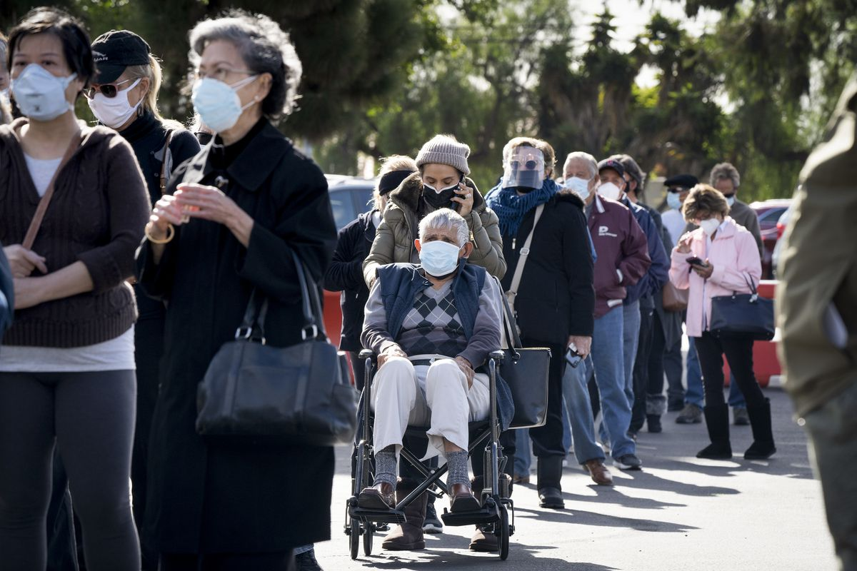 People standing in line to get vaccinated.