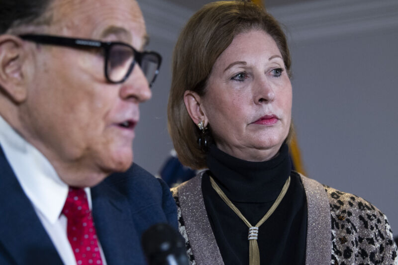 Sidney Powell, flanked by Rudy Giuliani, at a press conference on Nov. 19, three days before the Trump campaign publicly cut ties with her.