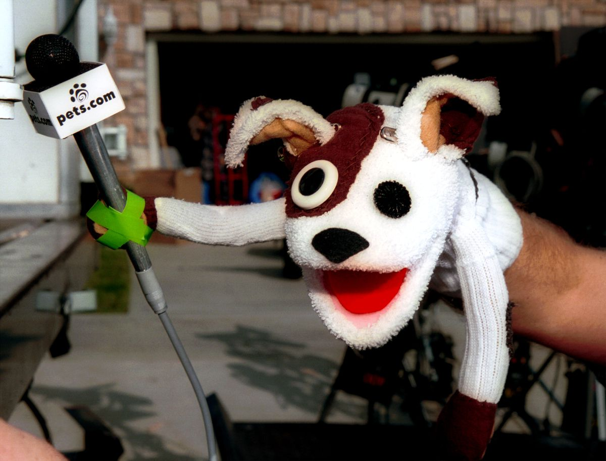 The pets.com sock puppet with a microphone taped to its paw.