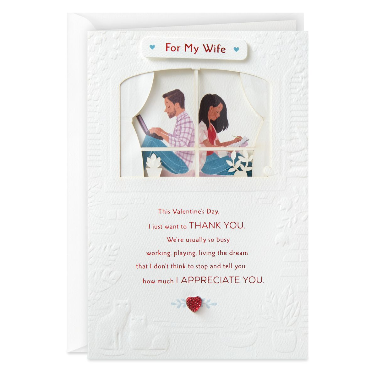 "A card with a man and woman sitting back to back in a house, reading ""For my wife: This Valentine's Day, I just want to THANK YOU. We're usually so busy working, playing, living the dream that I don't think to stop and tell you how much I APPRECIATE YOU."""
