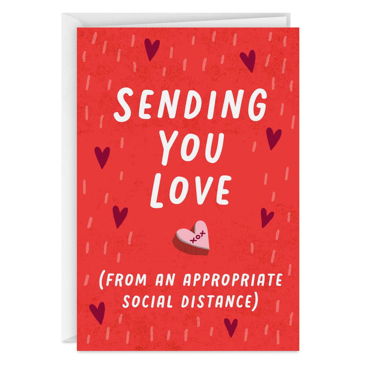 "A card with a candy heart reading ""Sending you love (from an appropriate social distance)"""