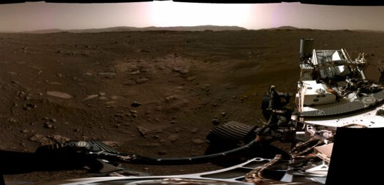 A rover's-eye view of a forbidding rocky landscape.