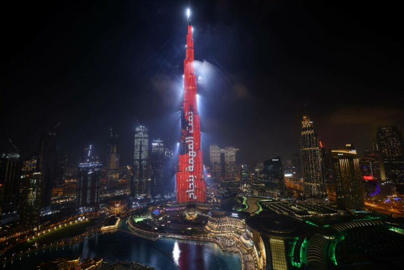 "Dubai's Burj Khalifa is lit up in red with a slogan reading in Arabic, ""Mission accomplished"" on February 9, 2021 as the UAE's Hope probe successfully entered Mars' orbit."