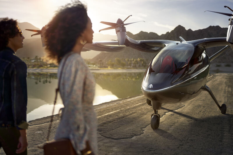 Passengers head toward a tiny aircraft that isn't quite a helicopter or a propellor plane.