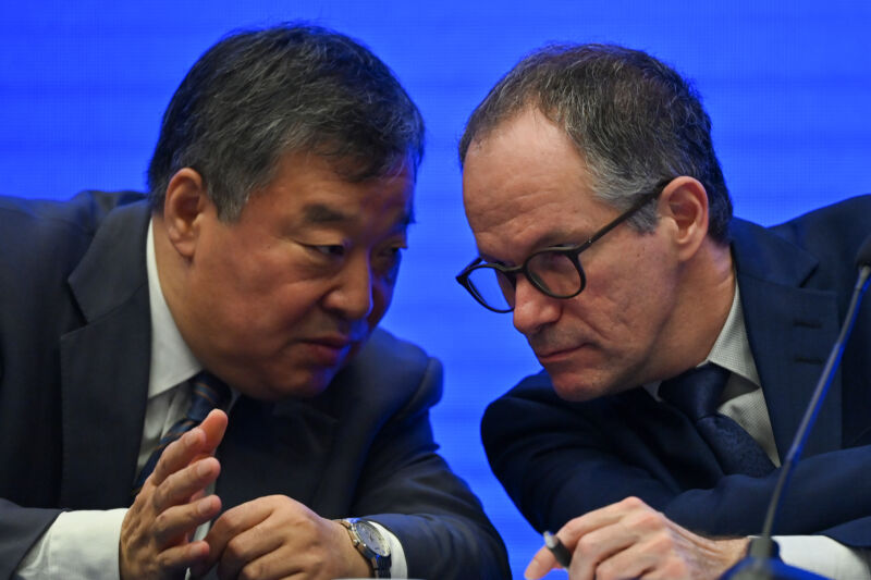 Peter Ben Embarek (R) talks with Liang Wannian (L) during a press conference following a visit by the international team of experts from the World Health Organization (WHO) in the city of Wuhan, in China's Hubei province on February 9, 2021.