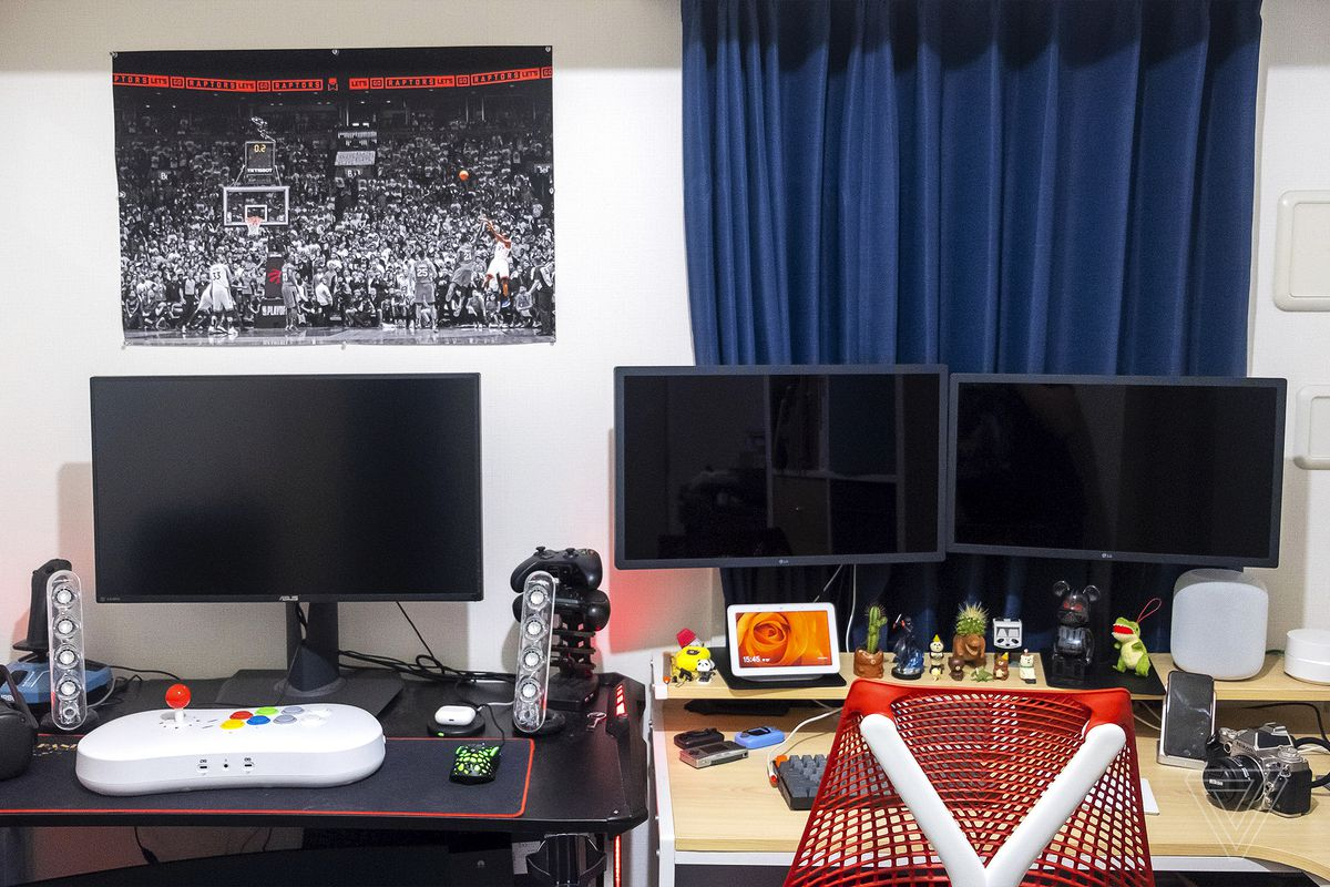 """The """"gaming"""" desk is on the left; the """"working"""" desk is on the right."""