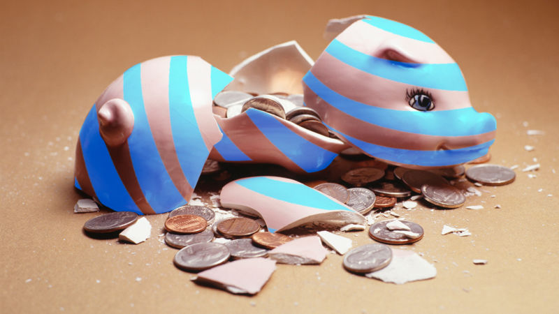 A broken piggy bank covered with AT&T's logo.